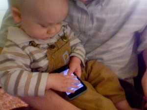 Tobias holding an iPod touch